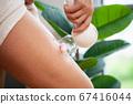 Woman getting LPG massage for skin care in beauty studio 67416044