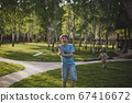 Laughing teenager with a badminton racket. 67416672
