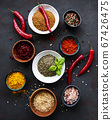 Various spices on a black background 67426475