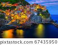 Mediterranean village with harbor at evening, Manarola, Cinque Terre, Italy 67435950
