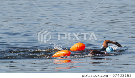 Two african american female swimmers swimming 67438162