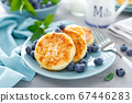 Cottage cheese pancakes, sweet curd fritters with 67446283