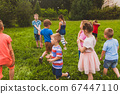 Children gathered in a local park to play ball 67447110