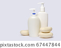 piece of soap and bottle of liquid soap over light grey backgound with clipping path 67447844