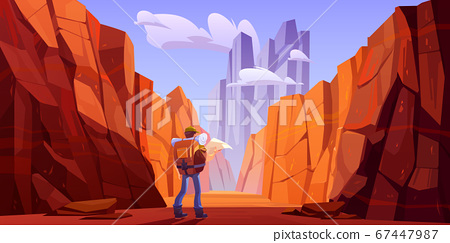 Hiker man with map on desert road in canyon 67447987