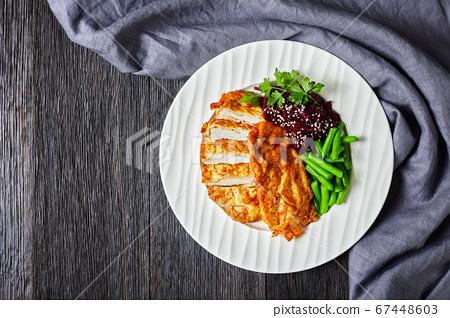 Chicken schnitzel, beetroot salad and green beans 67448603