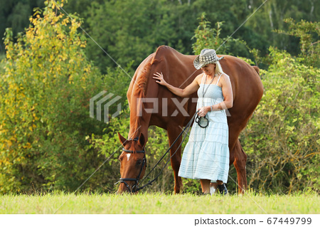 Portrait of woman and horse outdoors. Woman and 67449799