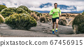 Trail run man athlete runner running marathon in desert landscape mountain hills summer background. Fitness and sports lifestyle 67456915