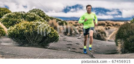 Trail run man athlete runner running marathon in desert landscape mountain hills summer background. Fitness and sports lifestyle 67456915