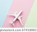 Airplane on pastel background 67458883