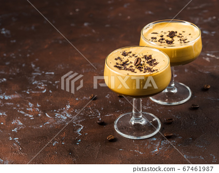 Frappe coffee in dessert glasses on brown backdrop 67461987