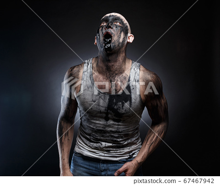 Bald man with black goo in the mouth 67467942