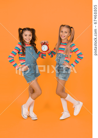 Small children smiling with mechanical clock. 67468805