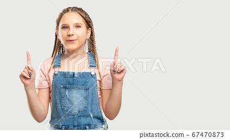 amazed child portrait ad background pointing up 67470873