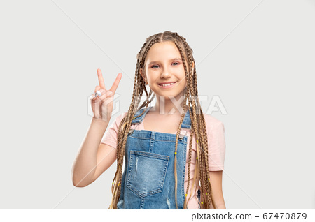 peace gesture victory success cheerful girl two 67470879