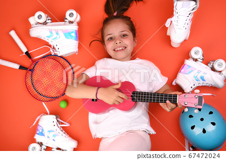 Girl 7 years and Roller skates in vintage style, helmet, ukulele, badminton, on a bright background 67472024