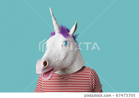 man wearing a unicorn mask 67473705