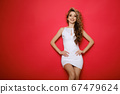 attractive female in white sporty dress isolated 67479624