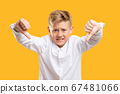 dislike gesture awful dissatisfied boy thumbs down 67481066
