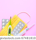 Pharmaceutical medicine tablets, thermometer and medical mask on pink background 67481810