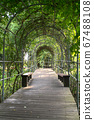 The walkway in the tunnel in a public park. 67488108
