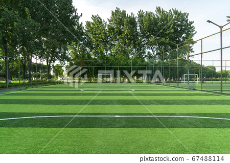The football field in a public park. 67488114