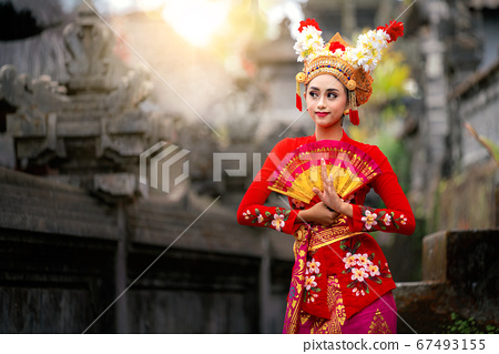 Indonesian girl with traditional costumn dance in 67493155