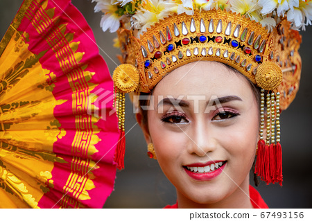 Indonesian girl with traditional costumn dance in 67493156
