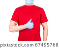 Man in red t-shirt and face mask and gloves showing thumbs up gesture isolated 67495768