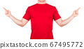 Man in red t-shirt pointing arm and fingers on the side isolated white 67495772