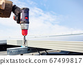 Solar engineer male hand working with drill 67499817