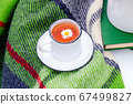 White cup of chamomile herbal tea with chamomile 67499827