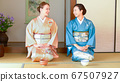 Foreign and Japanese women experiencing tea ceremony 67507927