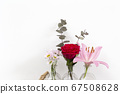 Collections of summer flowers in little glass vases near white wall, bright fresh red rose, pink lily and daisy flowers. Modern decoration home 67508628