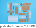Plasters on a blue surface 67510999