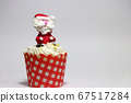 Christmas cupcakes decorated with Santa Claus. 67517284