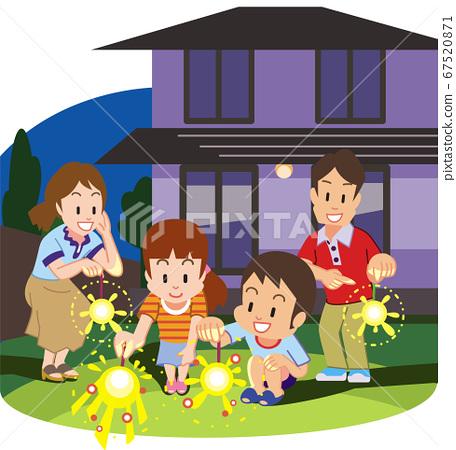 家庭在花園裡舉行手持煙花 67520871