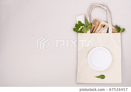 Textile bag for shopping. Eco household goods. The concept of recycling and reusable use. Layout 67526457
