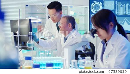 asian scientist team meeting 67529039