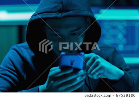 closeup of asian male hacker 67529180