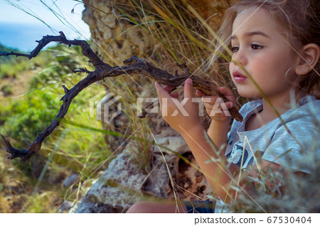 Little Boy Playing in the Forest 67530404