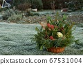 Autumn Floral Decorations In A Basket For A Grave For All Souls' Day On The Lawn 67531004