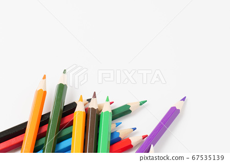 Multiple colored pencils on white background 67535139