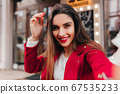 Excited brown-haired girl with stylish makeup 67535233