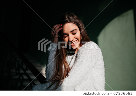 Pretty young woman smiling with eyes closed and 67536063