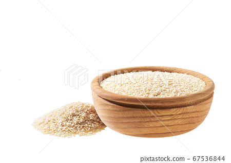 sesame seeds in a small wooden bowl  isolated on a 67536844
