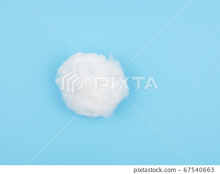 Cotton wool on a blue background. 67540663