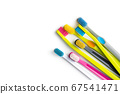 Various colorful toothbrushes. 67541471