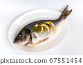 Dorada fish fried with lemon and parsley on a white plate and white background. 67551454