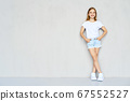 Young sportive girl in t-shirt and jeans shorts 67552527